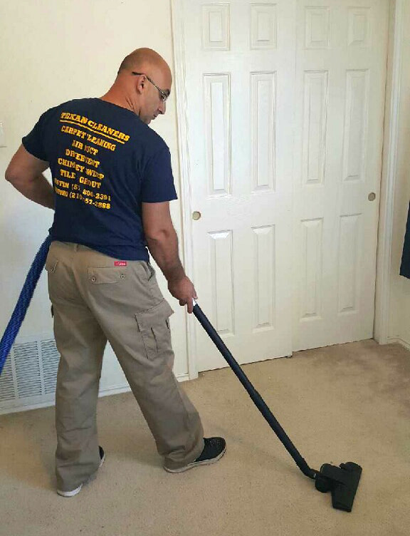 Cleaning the main room carpet